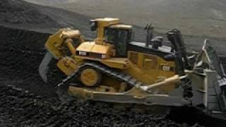 Caterpillar D11 R Pushing Quarry material off mountain . CAT D11 Crawler Tractor