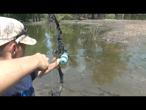 Nine Year Old Boy Bow Fishing River Monsters!