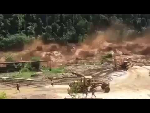 Dam rupture floods workers! ***strong images***