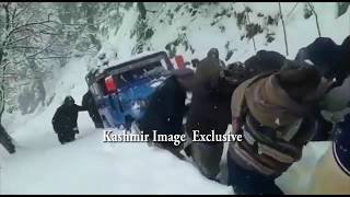 Villagers of Neelum Valley pull Jeep on blocked road during snowfall