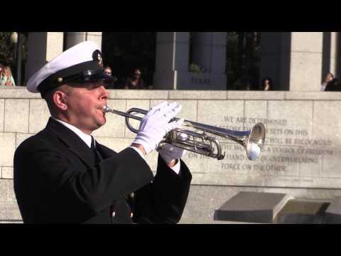 Bugler plays taps at the National World War II Memorial