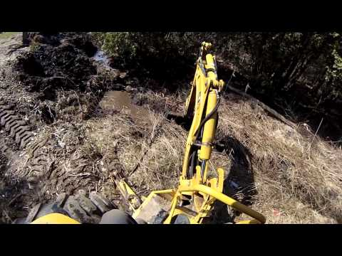 Excvating a trench to get water to drain out