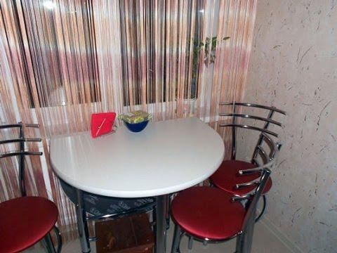 Подоконные столики в интерьере маленькой кухни