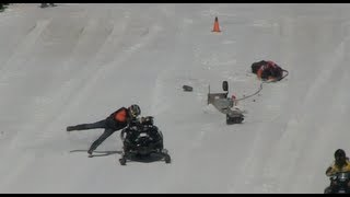 EPIC FAIL!  Snowmobile crash, close call for starting line official and driver.