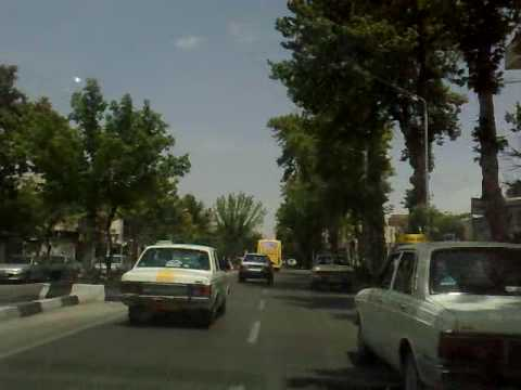 Mashhad, Iran streets, view from inside a taxicab + sounds of radio Mashhad in the background