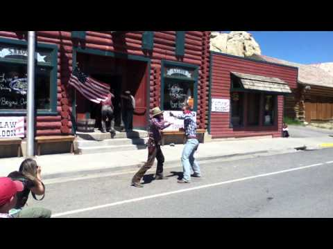 Old west fight outside of Outlaw Saloon
