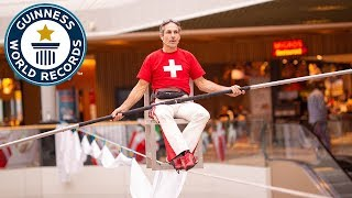 Longest time balancing on a chair on a tightrope - Guinness World Records