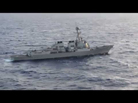 China sends warning after incursion of U S  naval warship near disputed islands,