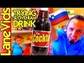 🇺🇸 AMERICANS TRY SLOVENIAN FOOD 🇸🇮 | Taste Test Slovenian Drink - Cockta Review | LaneVids