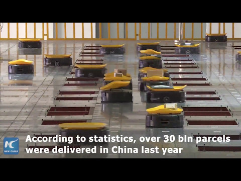 Army of robots sort out 200,000 packages a day