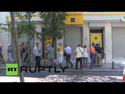 Greece: Athenians queue at ATMs after capital controls put in place