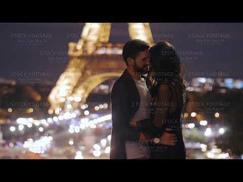 FRANCE, PARIS - OCT 2, 2017: Romantic Couple In Love In Paris At Eiffel Tower In Night.