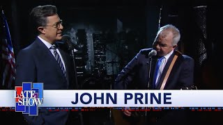 """John Prine And Stephen Colbert: """"That's the Way the World goes Round"""""""