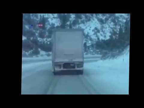 Fedex truck slides down icy interstate I-80 during snowstorm