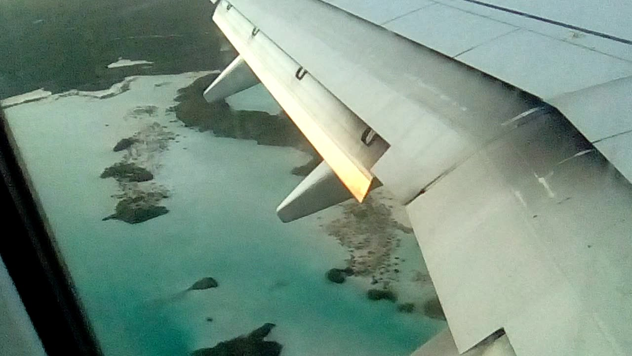 Sunset landing in Providenciales International Airport  Turks and Caicos  Islands