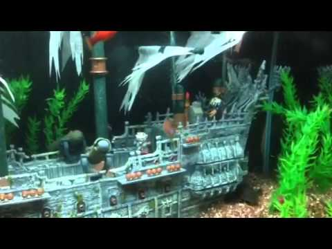 Pirates of the caribbean aquarium youtube for Fish tank pirate ship