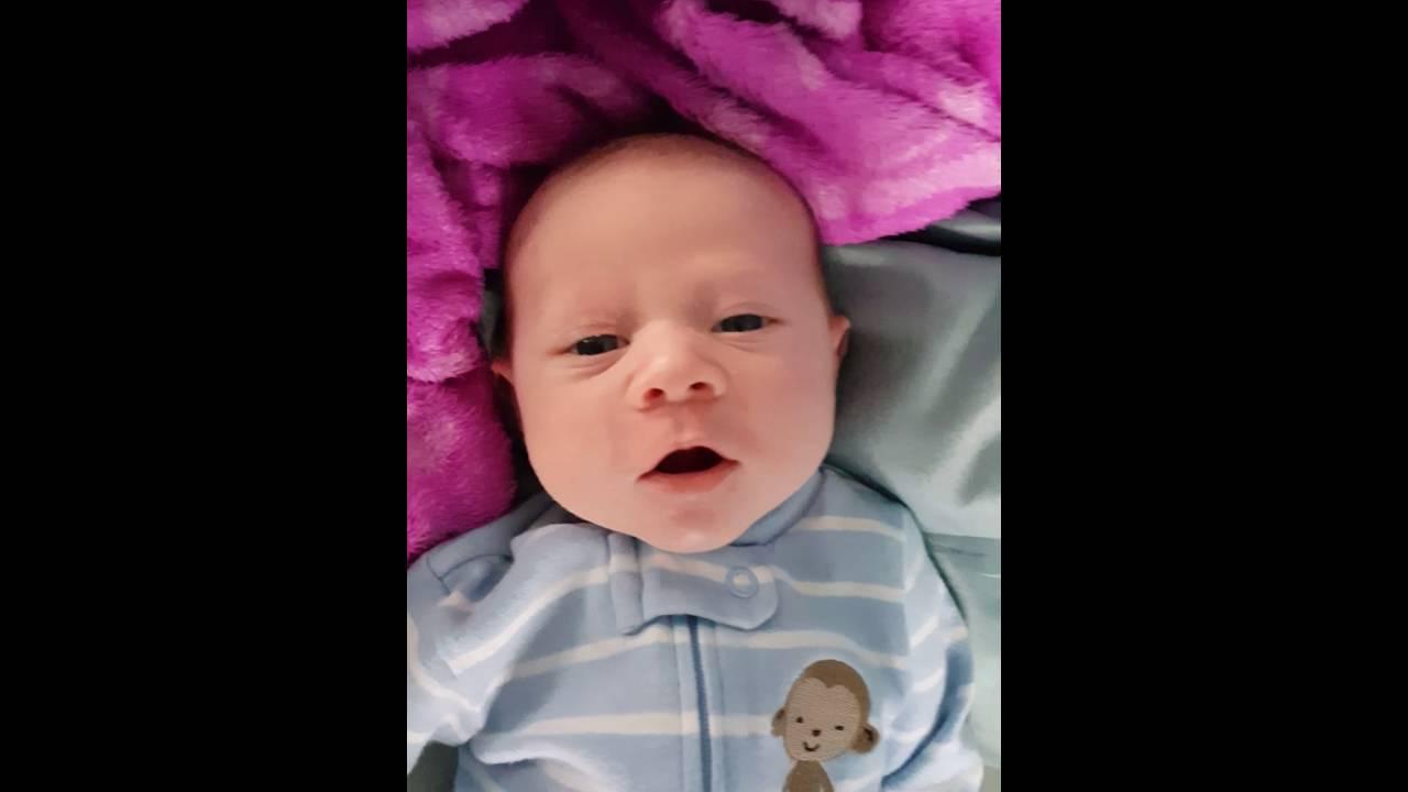 Baby Boy Elliott Smiling at 2 weeks old