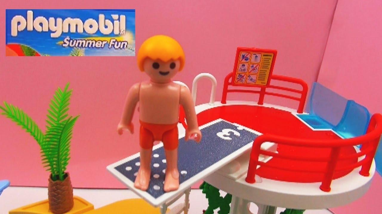 playmobil summer fun schwimmbad demo vater und sohn springen vom sprungturm und rutschen. Black Bedroom Furniture Sets. Home Design Ideas