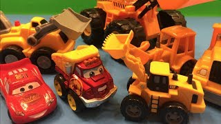 Disney Lightning McQueen and Mater watch bulldozers, excavators & big trucks