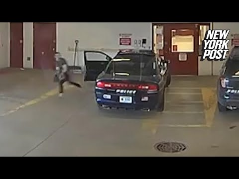 Suspect escapes cops by diving under closing garage door | New York Post