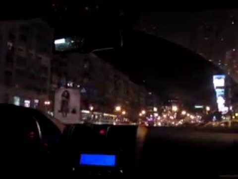 Driving at night in Bucharest while listening to your favorite music