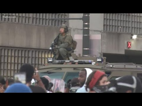 military-style-vehicles-moving-in-as-some-protesters-begin-breaking-local-shop-windows