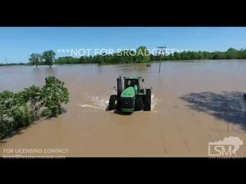 5-5-2017 Newport, AR - Farmer using Tractor in flood