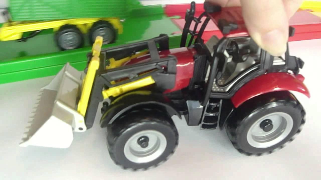 Детский трактор на педалях с прицепом купить в Минске.