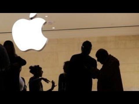 Apple falls as
