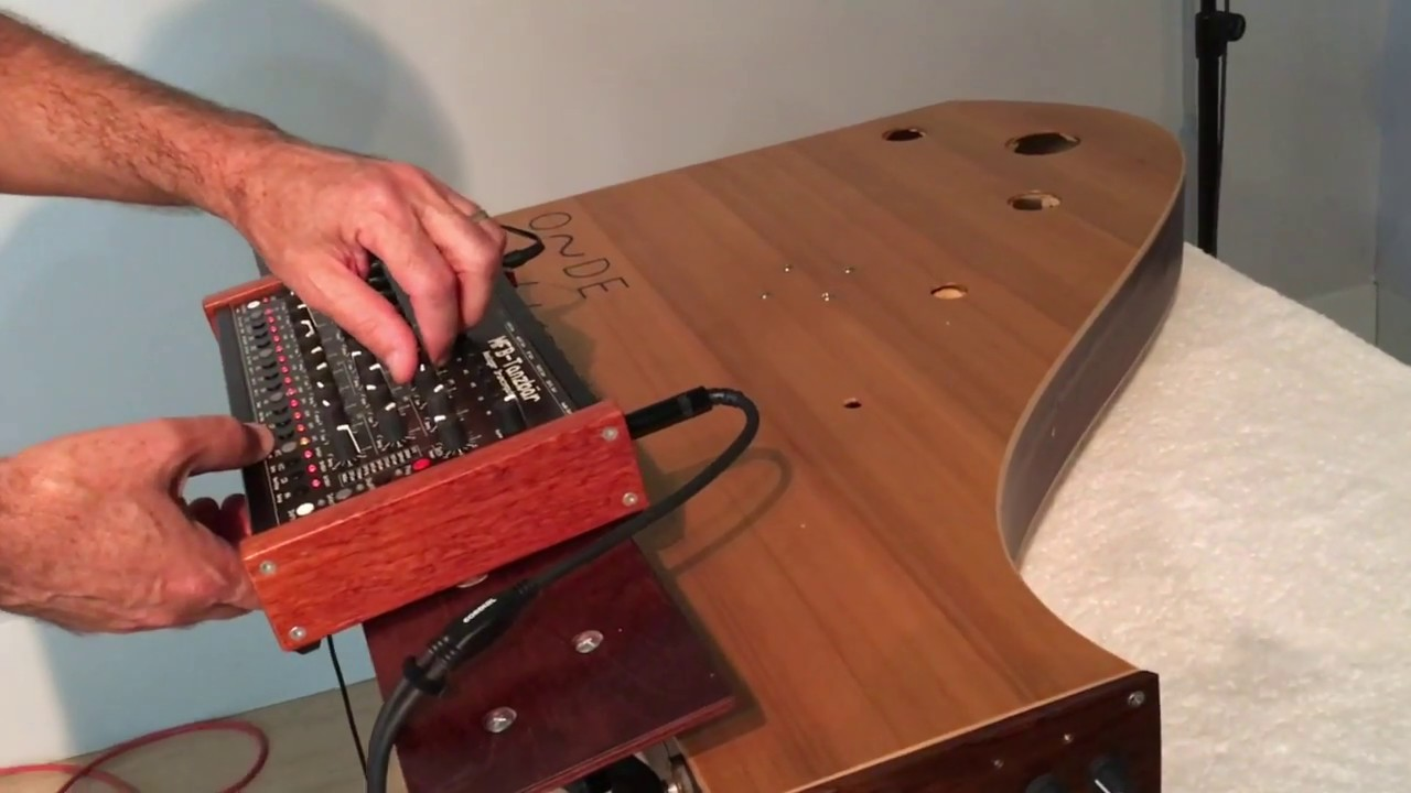 La Voix du Luthier: Powered, Acoustic Soundboard Resonator