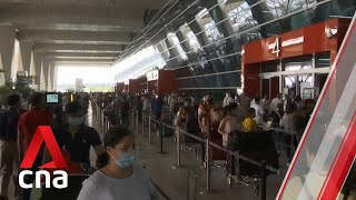 COVID-19: India hit by more travel bans as infections set global record