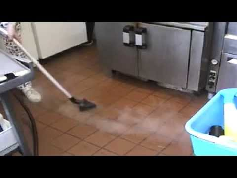 steam cleaner cleaning grease and grime in a industrial kitchen by morclean