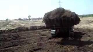 Track Loader Loading Truck