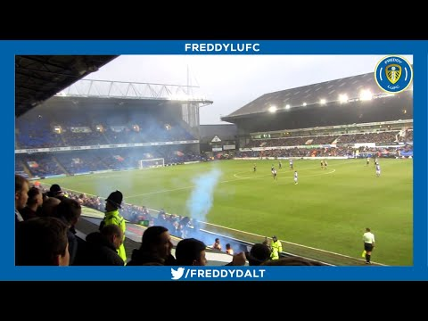 LEEDS FANS THROWING BOTTLES AND FLARES AT IPSWICH FANS AFTER RED CARD!