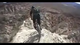 Repeat youtube video Inches from Death:  Downhill mountain biker rips cliffs in Utah