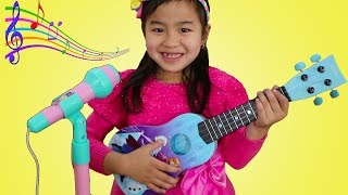 Jannie Plays with Disney Frozen Toy Guitar and Starts a Band thumbnail