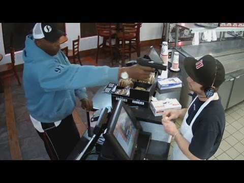 Watch Unfazed Cashier Keep His Cool During Terrifying Gunpoint Robbery