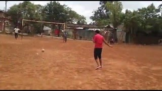 Ethiopian buddies on self balancing competition to kick a ball after a 10 times self swivel