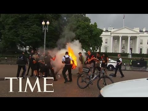 Protesters Burn American Flag Outside White House Ahead Of Trump Speech | TIME