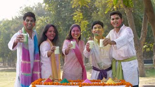Group of young friends happily giving greetings on Holi festival celebrated in India