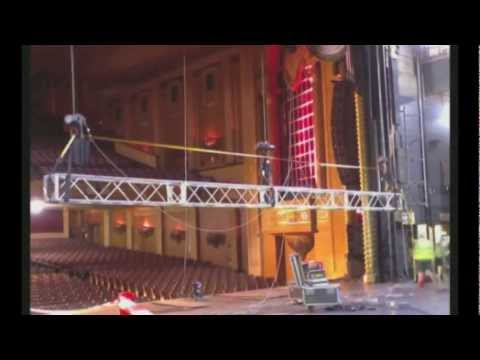 Specialty Theatre de-rigs a fire safety curtain