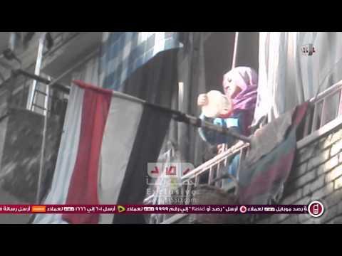 رصد | سيده مويده السيسى تلقي المياة مسيرة  ومنظمو المسيره يرفضوا اصابتها بمكروه
