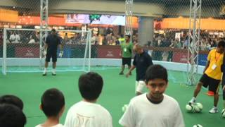 Premier League Superstars conduct a football clinic for children at Marina Bay Sands