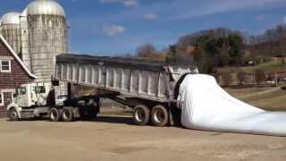 Unloading wet brewers grain into bag