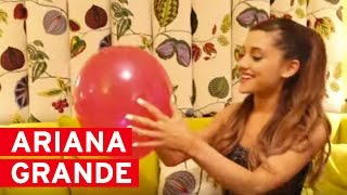 Ariana Grande popping the question balloons