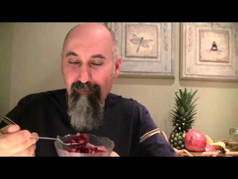Eating Bowl Of Pomegranate Seeds With Spoon