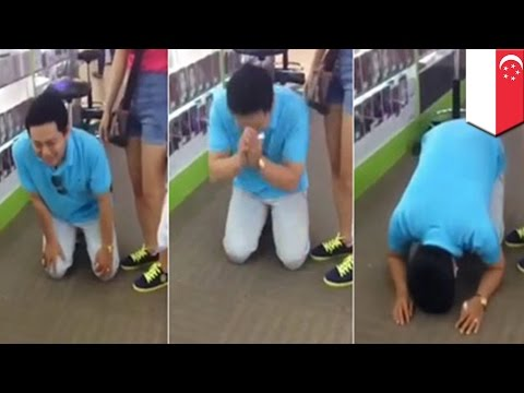 Video of Vietnamese tourist on his knees begging for refund from Singapore scammers goes viral