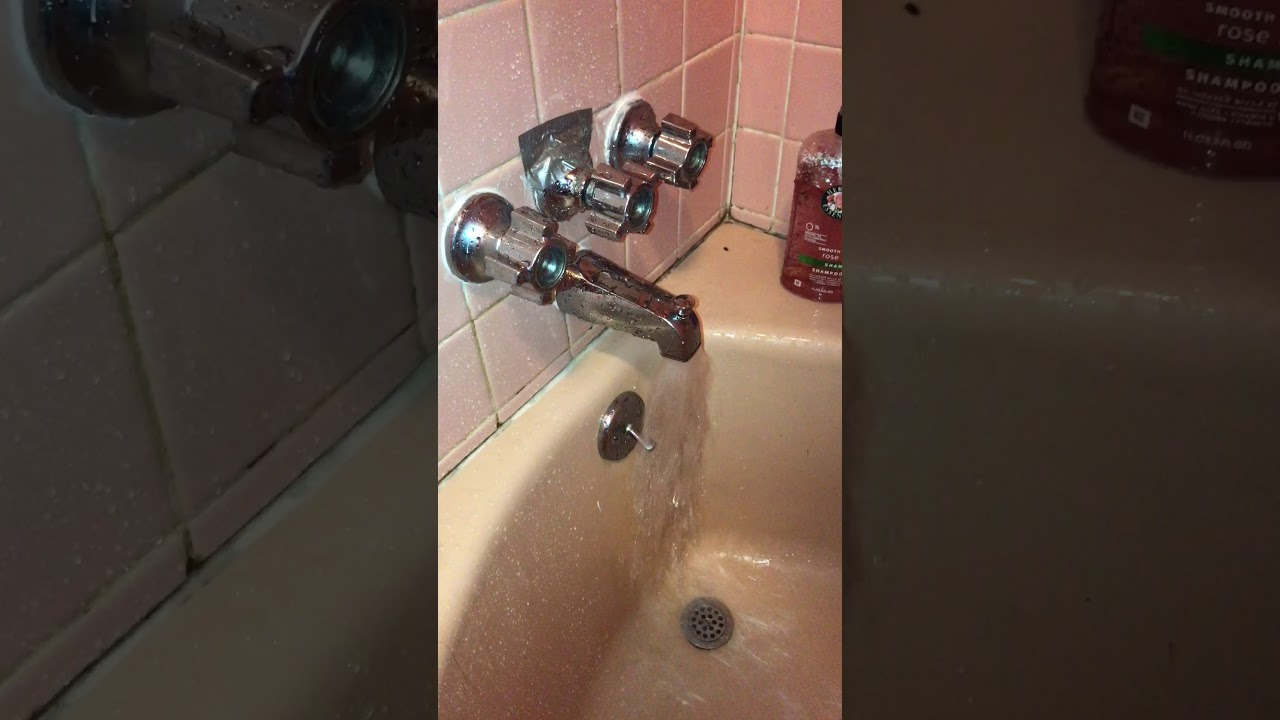 Faulty diverter: Water coming from shower head and tub spout - YouTube