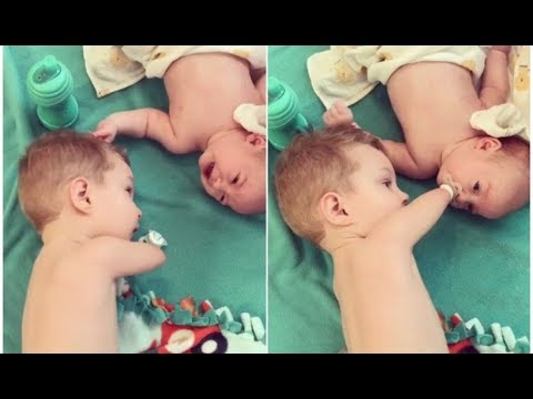 disabled-toddler-helps-brother-by-giving-him-his-pacifier-to-keep-him-from-crying
