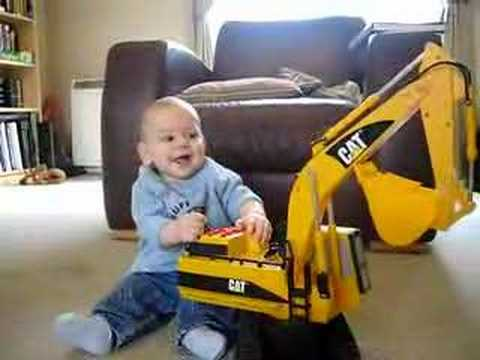 Evan playing with a toy digger